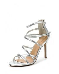 Женские серебряные кожаные босоножки на каблуке от Aldo