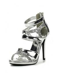 Женские серебряные кожаные босоножки на каблуке от La Bottine Souriante