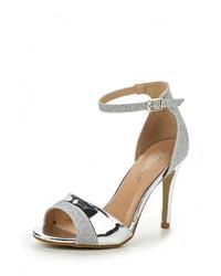 Женские серебряные кожаные босоножки на каблуке от Tulipano