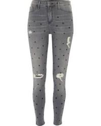 Серые джинсы скинни со звездами