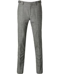 Серые классические брюки в шотландскую клетку