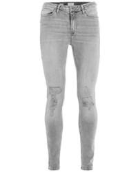 Серые рваные зауженные джинсы