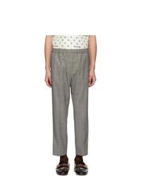 Серые шерстяные брюки чинос в шотландскую клетку от Gucci