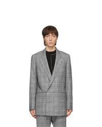 Серый шерстяной двубортный пиджак в шотландскую клетку
