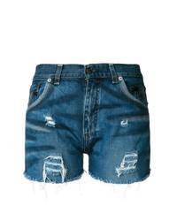 Синие джинсовые рваные шорты от Chiara Ferragni