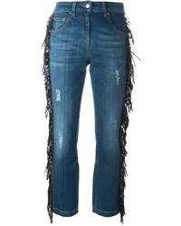 Синие джинсы c бахромой