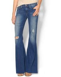 Синие рваные джинсы-клеш
