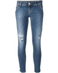 Синие рваные джинсы скинни