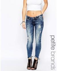 Женские синие рваные джинсы скинни