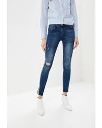 Синие рваные джинсы скинни от Modis