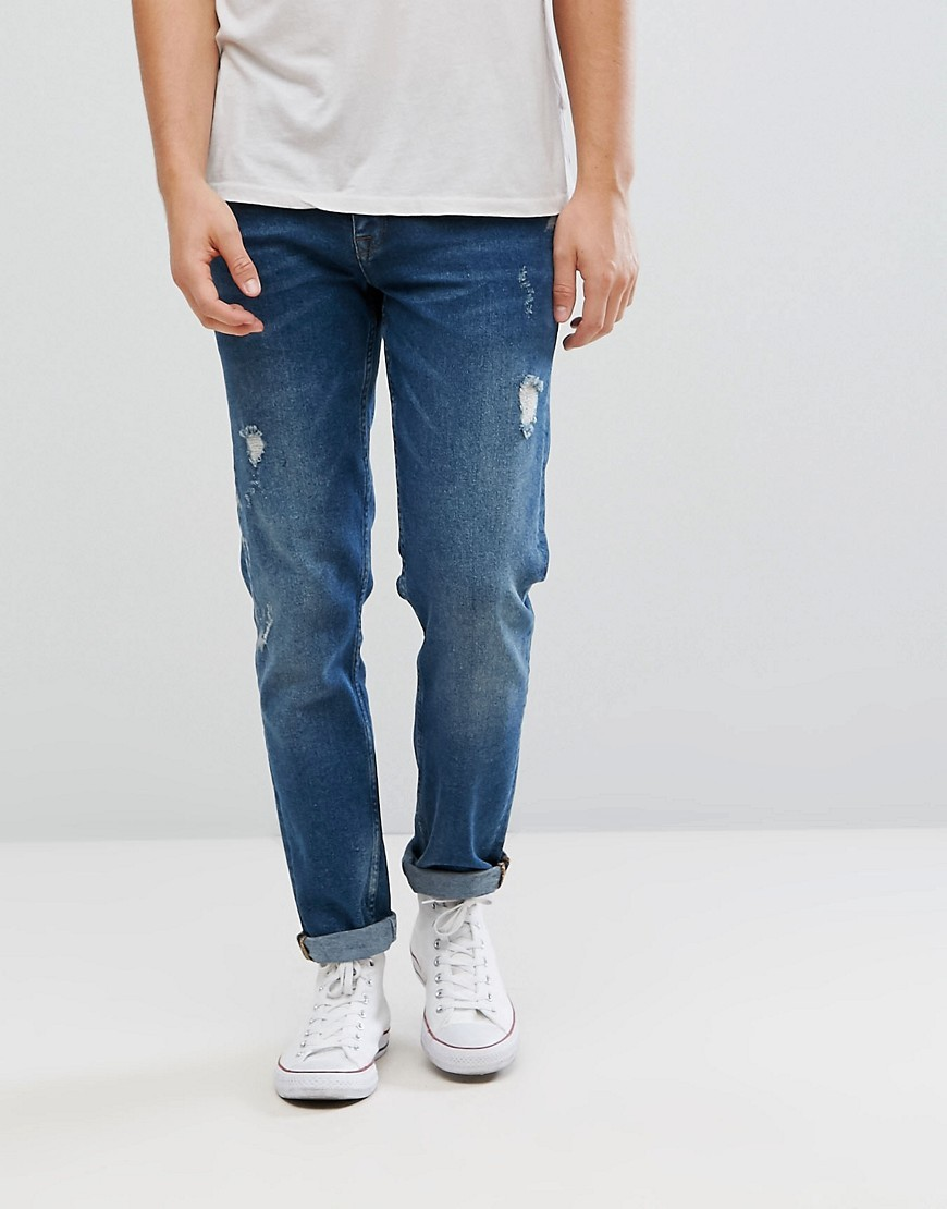 Мужские синие рваные джинсы от ASOS DESIGN