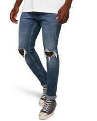 Синие рваные зауженные джинсы