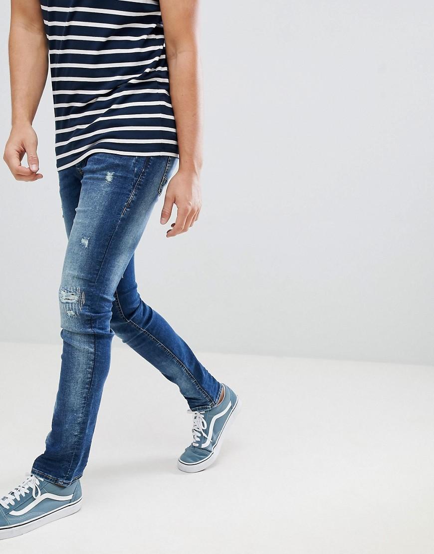 Мужские синие рваные зауженные джинсы от BLEND