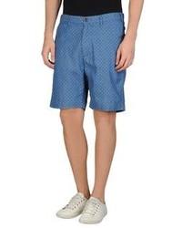 Синие шорты в горошек