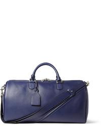 Синяя кожаная дорожная сумка
