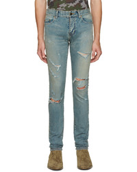 Темно-бирюзовые рваные зауженные джинсы