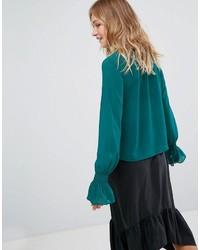 8e9610ef40e ... Темно-зеленая блузка с длинным рукавом с рюшами от Monki