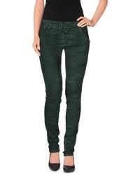 Темно-зеленые джинсы