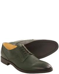 Темно-зеленые кожаные броги