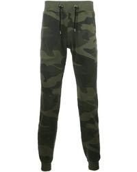 Темно-зеленые спортивные штаны с камуфляжным принтом