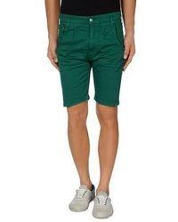 Темно-зеленые шорты