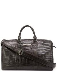 Мужская темно-коричневая кожаная дорожная сумка от Santiago Gonzalez