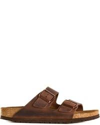 Темно-коричневые кожаные сандалии на плоской подошве от Birkenstock