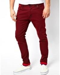 Темно-красные зауженные джинсы