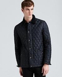 Темно-серая стеганая куртка с воротником и на пуговицах