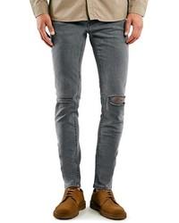 Темно-серые рваные джинсы