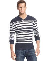 Темно-сине-белый свитер с v-образным вырезом