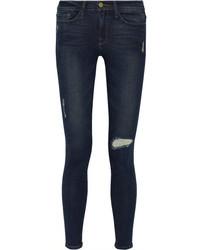 Темно-синие рваные джинсы скинни