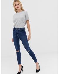 Темно-синие рваные джинсы скинни от ASOS DESIGN