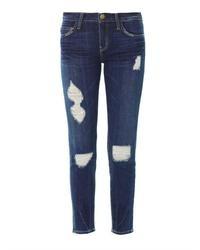 Темно-синие рваные джинсы