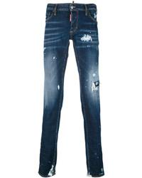 Темно-синие рваные зауженные джинсы