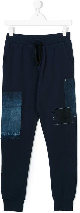 Детские темно-синие спортивные штаны для мальчику от Diesel