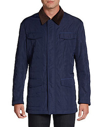 Темно-синяя стеганая куртка с воротником и на пуговицах