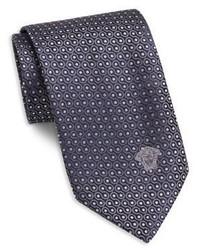 Фиолетовый галстук в горошек
