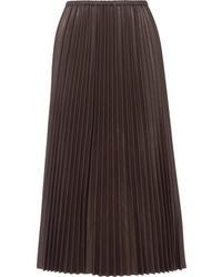 Черная кожаная длинная юбка со складками