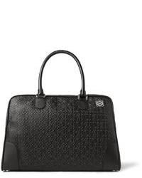 Черная кожаная дорожная сумка