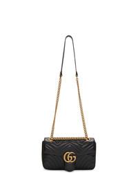 Черная кожаная стеганая сумка-саквояж от Gucci