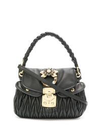 Черная кожаная стеганая сумка-саквояж от Miu Miu