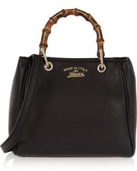 Черная кожаная сумочка от Gucci