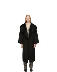 Женское черное пальто от Totême