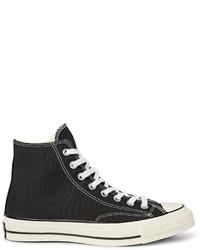 Мужские черно-белые высокие кеды из плотной ткани от Converse