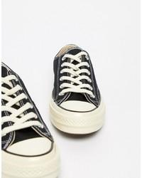 Женские черно-белые низкие кеды из плотной ткани от Converse