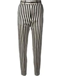 Черно-белые узкие брюки в вертикальную полоску