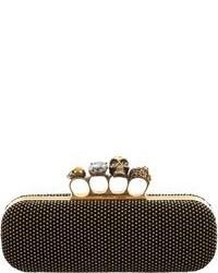 Женский черно-золотой замшевый клатч с украшением от Alexander McQueen