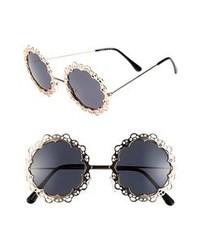 Черно-золотые солнцезащитные очки с украшением