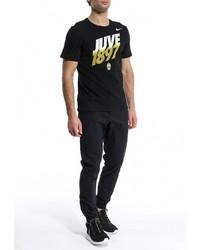 Черные брюки чинос от Nike